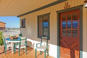Ranch Porch Workers Compensation Captives Overlooking Horse Table