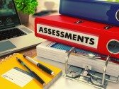 Office Table With Mid-policy Assessments Documents