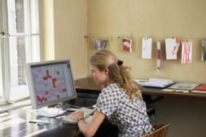 Picture Woman Using Computer Small Screen in Office