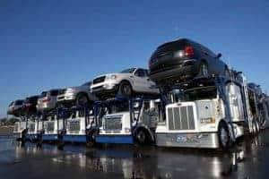 Picture Of Trucks With Cars Above Assigned Risk Pool Trucking Companies