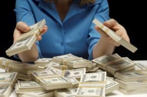 Woman Counting Four Workers Compensation Money Bundled