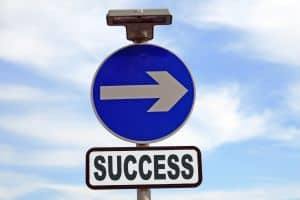 Arrow signage Four Workers Compensation Success