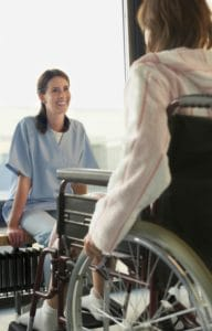 Picture Of Patient On Wheelchair Zero Sum Game Listening To Physical Therapy