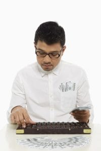 Picture Of Man Computing Money WCMSA Using Abacus