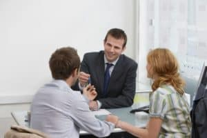 Agent Talking Couple WCMSA On Office