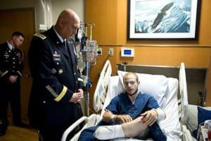 Picture Of Chief Talking To NC Workers Comp Army Injured