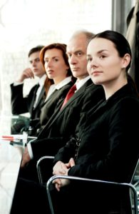 Picture Of NC Workers Comp Employee Sitting A Row