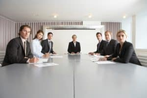 Businesspeople At North Carolina Workers Compensation Conference Table