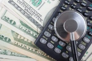 Graphic Of Dollars And Stethoscope on Calculator Medicare Set Aside Enforcement