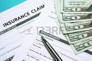 Graphic Of Insurance Form And Dollars Workers Comp Reserving WC claim's