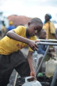 Picture Of Child Getting Charity Water On Faucet