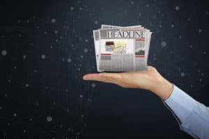 Hand Presenting Investigates Captives Headline News Paper