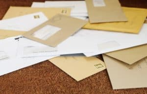 Pile Of Letters Premium Audit Disputes On Doormat