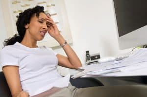 Worried Woman Doing Undisputed Premiums Finances