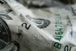 Close up picture of Payroll Audits Cover money