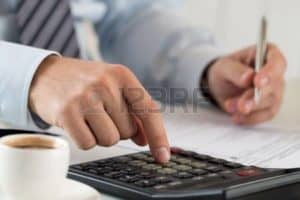 Graphic Of Businessman Calculating Workers Compensation Audits Concept