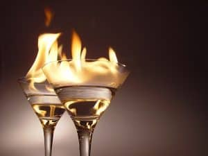 White Glass Of Alcohol Risk With Fire