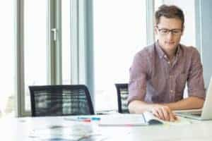 Picture Of Man In Office Doing Papers Work No Bathroom Breaks At The Table