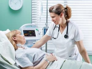 Picture Of Nurse Practitioners Talking To Patient