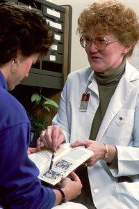 Woman Nurse Practitioners explaining to woman patient
