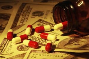 Pill Capsules Workers Comp Costs On US Paper Currency