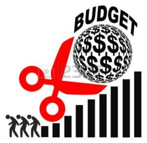Vector Graphic of Big Scissor Cutting Budget Advisory Loss Costs Premium Bill