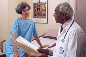 Doctor Medical Utilization Consults With Patient