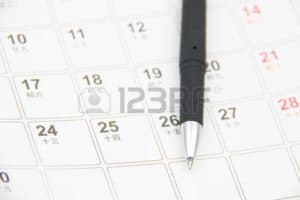 Picture of Pen On The Top Of Calendar Workers Comp Dates Very Important