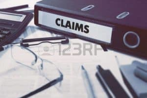 Picture of Claims Files On The Table Cancellation Notice Employer Received