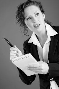 Woman Reporter North Carolina HB 237 Holding A Pen And Notepad