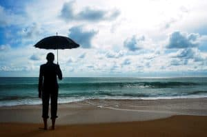 Woman Holding Umbrella Federal Insurance Office On The Beach