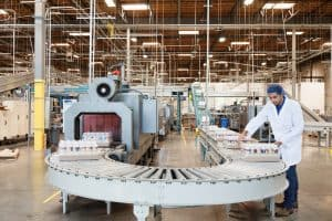 Picture Man Working in Bottling Industrial Commission Rule Changes