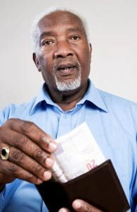 Picture Senior Man Taking Out Money from His Wallet TPA Fees New Jersey