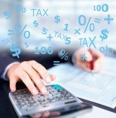 Picture of Auditor Auditing Workers Comp Calculating Tax And Dollars Graphics