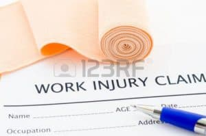 Picture of First Reports Work Injury Claim Form Bandage and pen on top