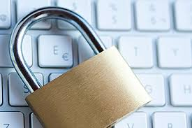 Picture of workers comp privacy Padlock Top Of Keyboard
