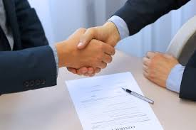 Picture of Two Man Hand Shaking Premium Auditor Asked Agreement
