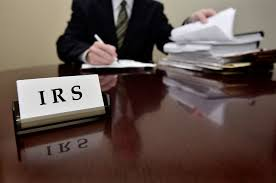 Picture of subcontractor IRS doing office papers