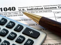 Picture of Tax form Subcontractor with pen and calculator on top