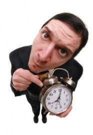 Picture of Man holding a alarm clock Workers Comp Premium Saving
