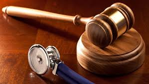 Picture Of Gavel And Stethoscope Workers Comp Benefits Taxable Concept