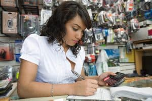 Woman Working Mod Calculation On Shop