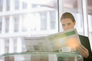 Woman Real Study Results Reading Newspaper