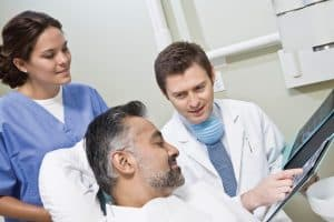 Doctor And Patient Affordable Care Act Looking At X Ray