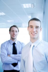 Businessmen Liability Insurance Smiling At Camera