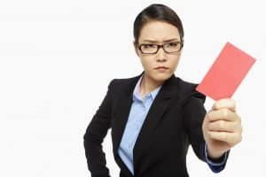 Angry Woman Post Audit Policy Holding Red Card