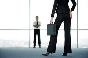 Businessman Waiting For Californias WCIRB Businesswoman Carrying Case