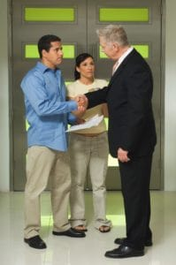 Picture Of Businessman Shaking Hand Settlement Authority with Couple