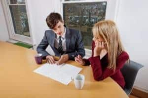 Picture Of Young Businessman and Female WCIRB With Paperwork Conference Table
