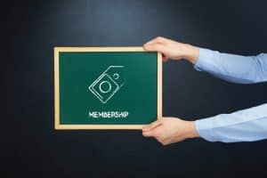Hand Holding Federalization of Workers Comp Blackboard Membership Concept